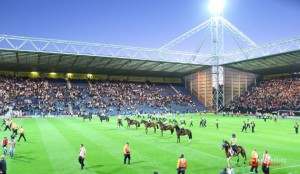 Police horses on the pitch at Deepdale as order was restored