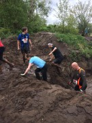 My older brother (blue t shirt) watching whilst I run through mud