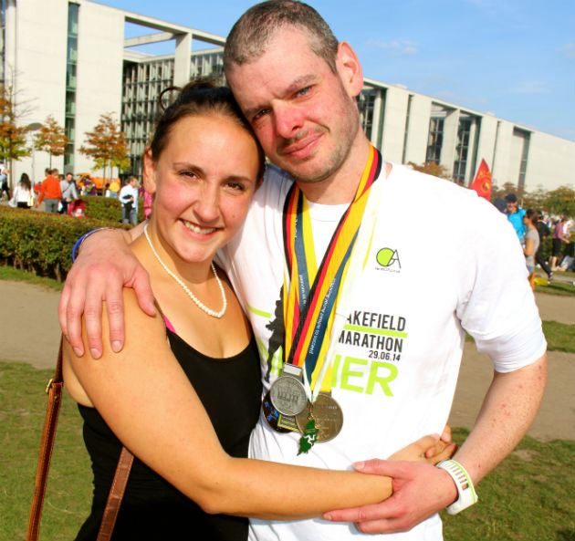 Ben with his wife Louise and all his marathon medals