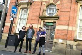 UCLan graduates outside the Birley Studios