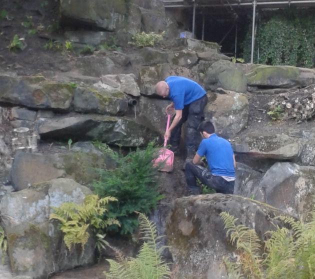 Workmen in the grotto