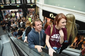 Students stream up the escalators in the St George's Shopping Centre