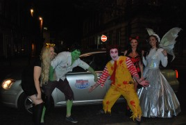 Another bunch of Halloween revellers amazed by the PrestFest fairy paying for their taxi
