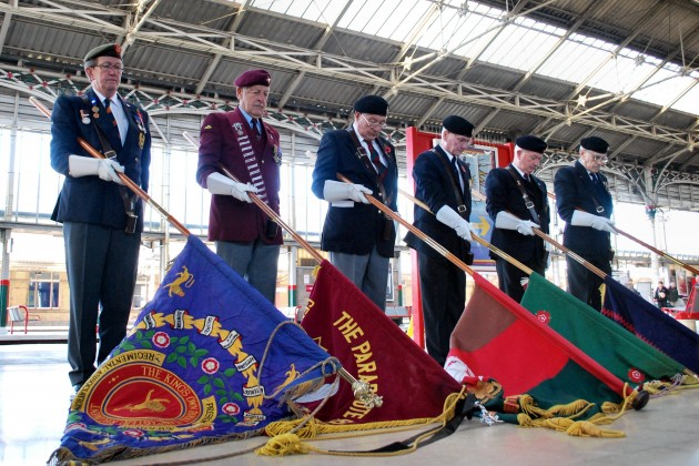 RASC RCT Standard Bearers of the Preston Branch perform their solemn duty at the memorial