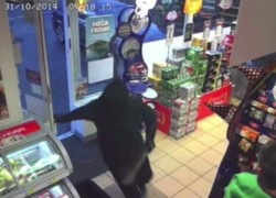 One of the gang armed with a machete bursts into the store