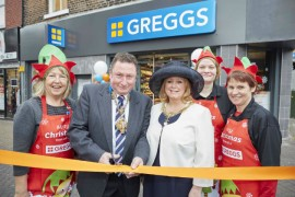 Cutting the ribbon at the Market Square Greggs