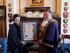 Lady Milena Grenfell-Baines with Mayor, Councillor Nick Pomfret holding the Freeddom Scroll