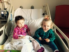 Pippa, left, in hospital on Saturday with her sister Betsy