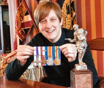 Curator Jane Davies with Sam Boast's medals
