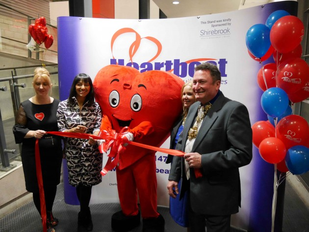 The officall opening by cutting the ribbon. From left to right - Heartbeat CEO Jill Rogerson, ITV's Good Morning Britain presenter Ranvir Singh, Heartbeat mascot Cardiac Carl, Mayoress of Preston Barbara Pompret and Mayor of Preston Nick Pomfret