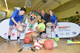 Ben, 11, with Peter Dodding of SPAR and Maddie, 10