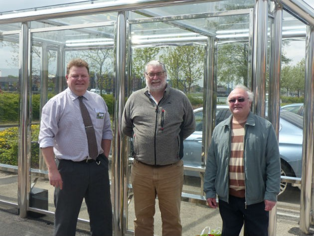 Andrew Savage, Morrisons store manager, councillor Robert Boswell and a bus user
