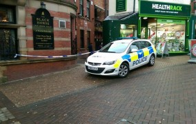 Police remain on the scene in Orchard Street on Tuesday