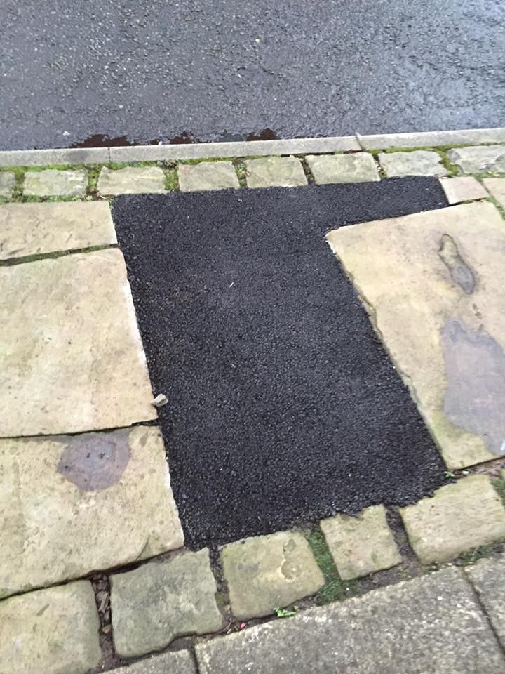 The patched up pavement