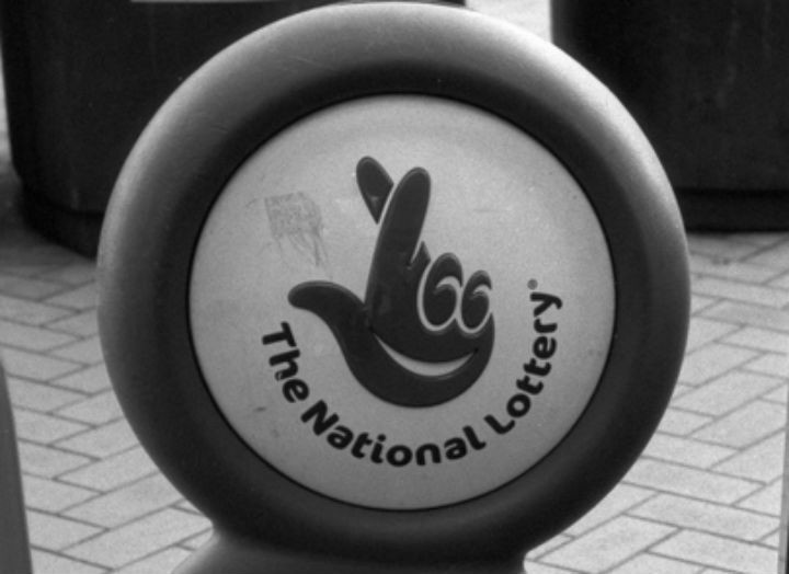 National Lottery logo Pic: Man With Red Eyes
