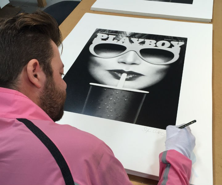 Simon Claridge signing one of his prints
