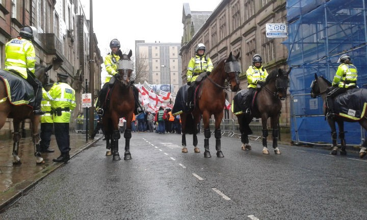 Police horses hold the line in Birley Street