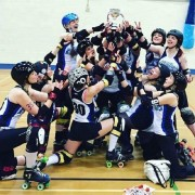 The Roller Girls celebrate their Tier 4 victory