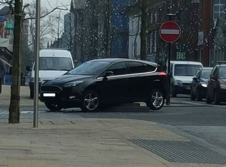 Another view of the car stuck in Fishergate