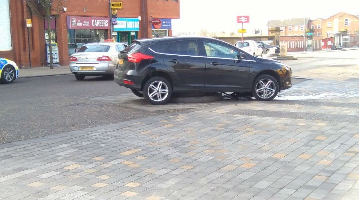 The car is stuck on the mini-roundabout in Fishergate Pic: Keith Martin