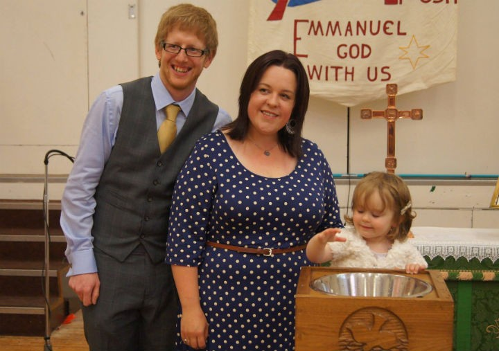 A baptism taking place in the new Emmanuel Church