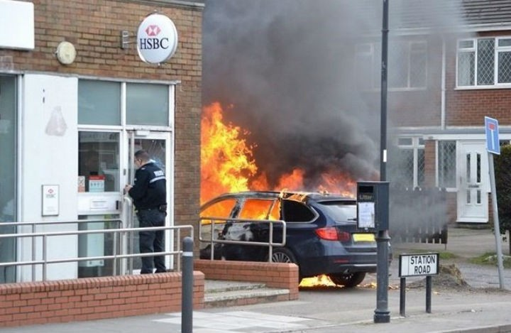 The BMW on fire outside the HSBC in Hesketh Bank