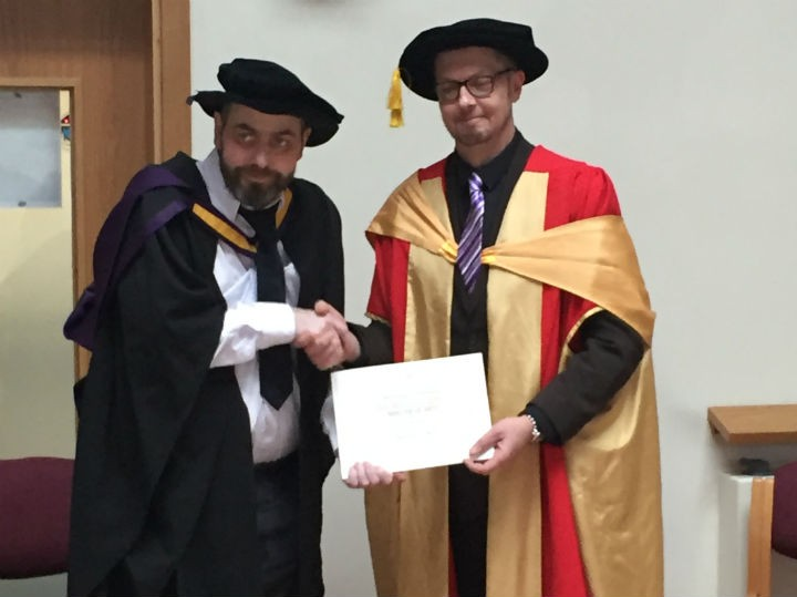 Max receiving his masters degree in late February