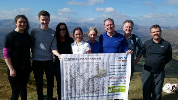 Conlon staff on Wansfell Pike in the Lake District during a training session
