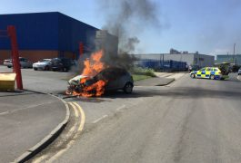 Flames licked round the car as police closed the road Pic: Lancashire Road Police