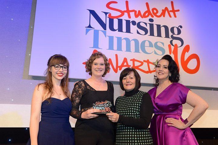 Deborah, second from left, receiving her award