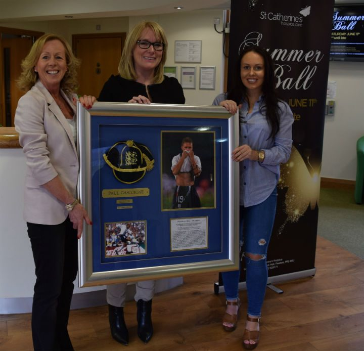 Margaret Calvert, Lynne Whittaker and Laura Calvert with the signed Gazza memorabilia