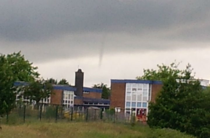 Ashton Primary School with the funnel cloud above it