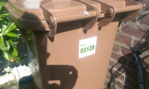 The stickers appearing on brown bins across Preston