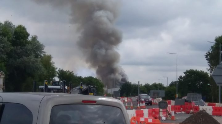 Plumes of smoke can be seen from roads near the Lostock Hall site