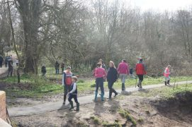Families enjoying a previous treasure hunt in the woods