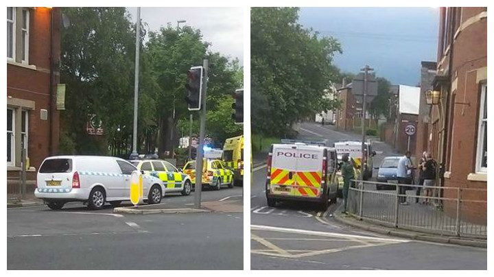 Police and ambulance vehicles outside the pub