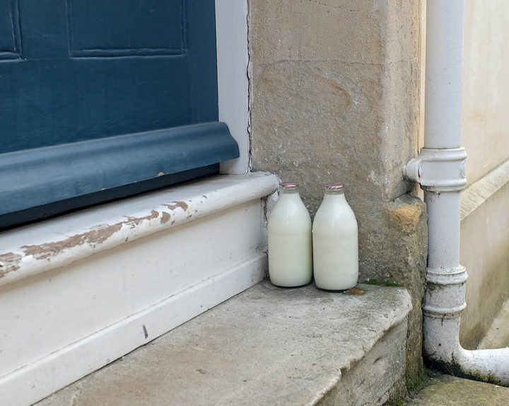 Milk bottles on a doorstep Pic: Clive Jones