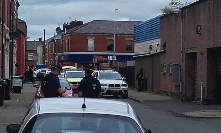 Armed officers stand guard in St Matthews Pic: Phil Hobson