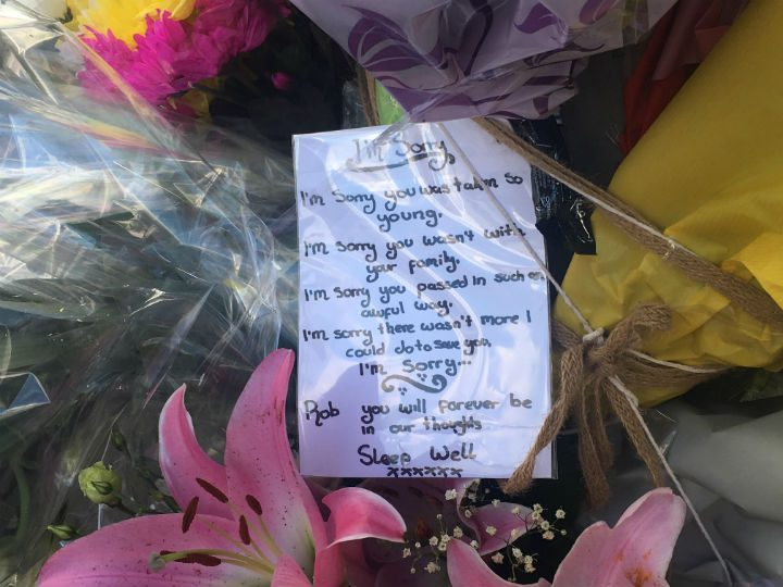 A floral tributes left at the scene of the crash in London Road Pic: Olivia Baron