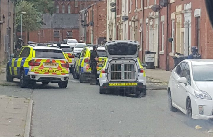 Armed police in Skeffington Road Pic: Ryan Moss