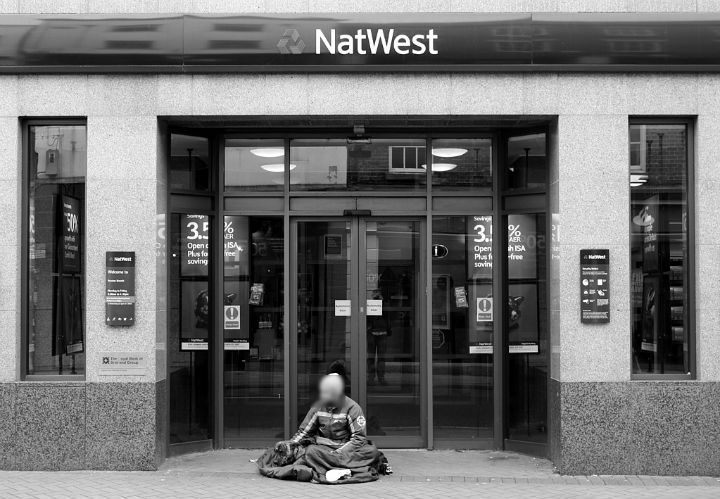 A man sits on Preston's streets Pic: KrzysztofTe Foto Blog
