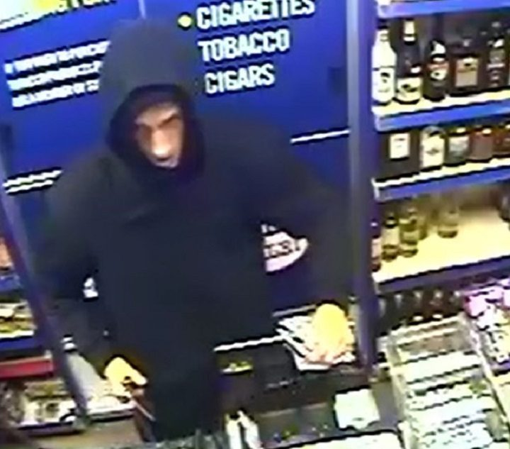 A man seen behind the till in the Linden Drive shop