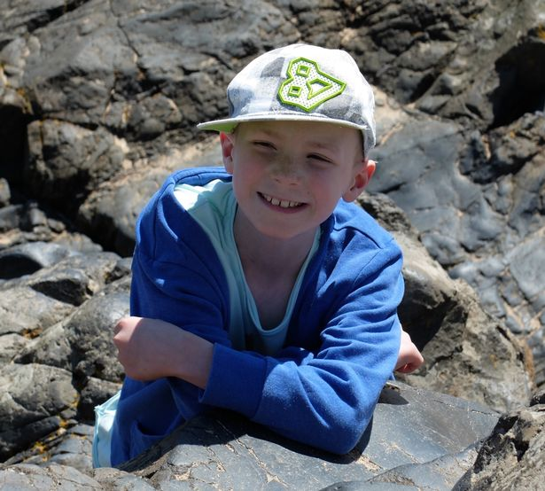 Saul pictured during summer 2014 - just months before his deaths - on a family holiday