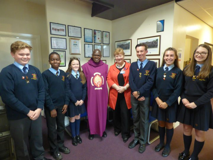 Archbishop Sentamu with  pupils and headteacher at Archbishop school