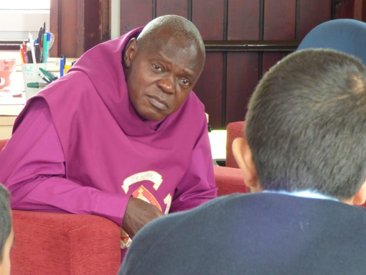 The Archbishop speaking with one of the pupils