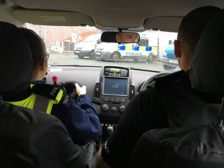 View from inside one of the police vehicles during the operation
