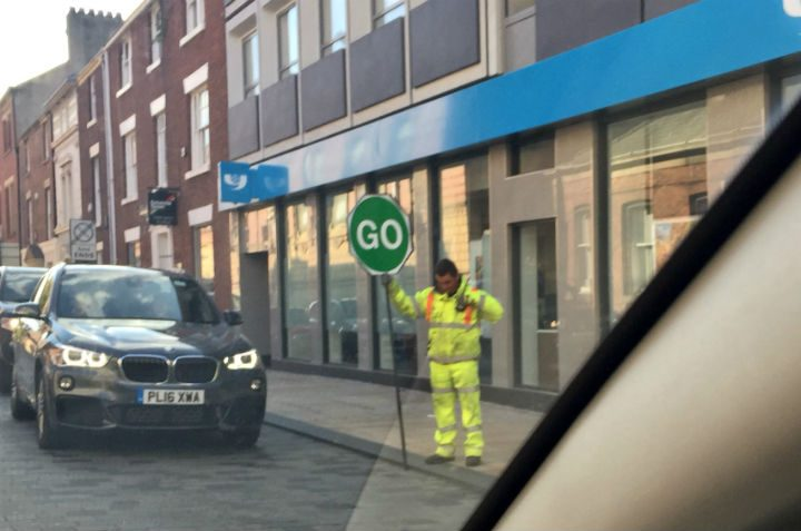 Another man with a stop-go signal in the city centre Pic: Louise Hogg
