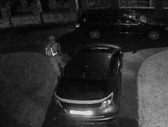 CCTV picture released by South Ribble Police of man in driveway after trying a car door