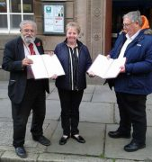 Patricia Varty handing in the petition at the Town Hall, flanked by Ribbleton councillor Jonathan Saksena and deputy leader councillor Jon Swindells