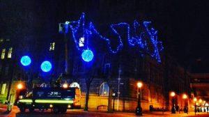 Christmas lights going up on the Flag Market